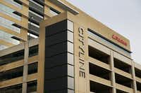 Building One is seen behind a parking garage at State Farm's CityLine Project in Richardson. (Tom Fox/The Dallas Morning News)