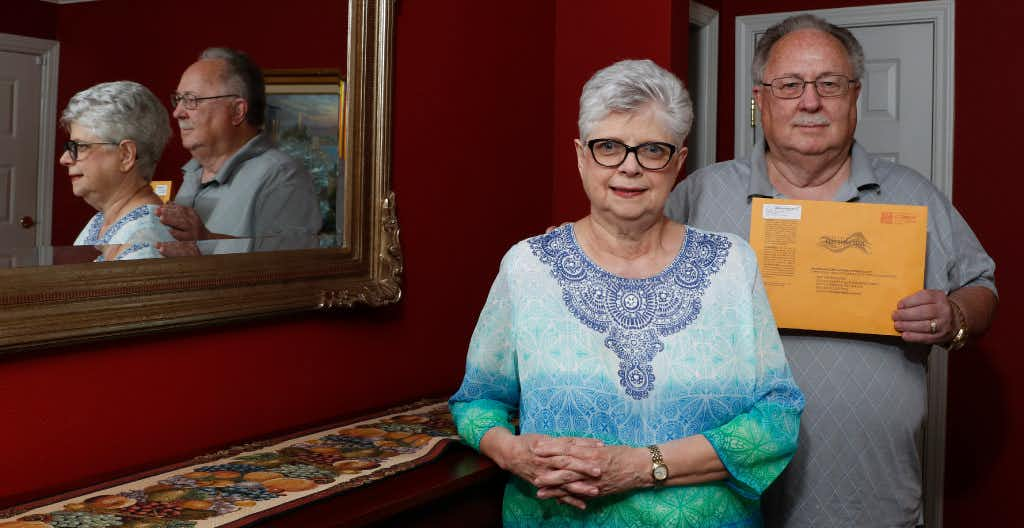 "Annette and Steve Perkins, both 70, are among dozens of potential victims of voter fraud this election cycle. Steve holds the ballot he received in the mail at their home on Thursday, April 27, 2017 in Grand Prairie, Texas. They both received Dallas County ballots in the mail that they did not request. Gloria filled it out and left it on her doorstep for the mailman. But she found out later that someone might have fraudulently tampered with it, because the county elections office said someone marked himself or herself as a witness on her ballot as ""Jose Rodriguez"" but she doesn't know anyone by that name. The same name has been appearing on elderly people's ballots across West Dallas and Grand Prairie this election cycle, prompting concerns of widespread voter fraud. (David Woo/The Dallas Morning News)(David Woo/Staff Photographer)"