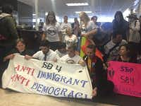 <p>Protesters held a sit-in at Texas Gov. Greg Abbott's office on May 1 in opposition to Senate Bill 4. Under the legislation, local law enforcement agencies and officials could be punished for failing to comply with federal immigration laws.</p>(Elena Lutz/San Antonio Exprss-News)