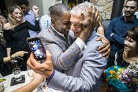 Plano mayoral incumbent Harry LaRosiliere, center left, hugs Fehmi Karahan after the majority of polls reported in his favor at an election night campaign party on Saturday, May 6, 2017 at Mexican Sugar restaurant in Plano. (Ashley Landis/Staff Photographer)