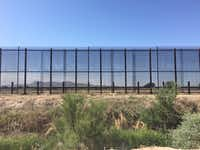 The border fence in Tornillo is on private land owned by a pecan farmer in West Texas. Mountains in Mexico are visible through the 18 foot fence.(Angela Kocherga/Staff)