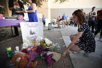 Rosie Atkinson leaves flowers during a memorial held for Janeera Gonzalez, the North Lake College student slain Wednesday, at Irving High School in Irving, Texas on May 8, 2017. (Nathan Hunsinger/Staff Photographer)