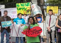 Maria Duque speaks during a protest outside of the Texas Governor's Mansion in Austin, Texas, Monday, May 8, 2017. (Ricardo B. Brazziell/The Associated Press)