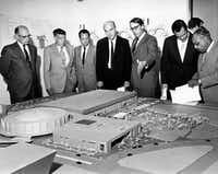 In 1969, Dallas Mayor J. Erik Jonsson (center) and architect E. G. Hamilton (to Jonsson's left, motioning) view a model of the Dallas Convention Center project. (Jim Work/Staff Photographer/<p>Dallas Public Library-Texas/Dallas History and Archives Division/The Dallas Morning News Collection</p>)
