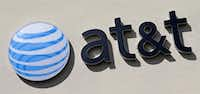 This Feb. 8, 2017, file photo shows the AT&T sign at a store in Hialeah, Fla. (Alan Diaz/AP)