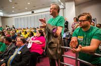 Lawrence Sweeny, center, and Ryan Roskey, right, applaud during public comment before the board of the Dallas Area Rapid Transit before they voted on a rail corridor plan on Tuesday, October 25, 2016 at DART headquarters in Dallas. The board voted to finance both the Cotton Belt and D2 subway.(Ashley Landis/Staff Photographer)