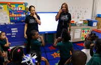 <p>Principal Onjaleke Brown (right) participates in a song with Pre-K teacher Librada Gil and her students at N.W. Harllee Early Childhood Center in Dallas. Onjaleke started in Dallas ISD as a 3-year-old, later graduating from Kimball High School.</p>(David Woo/Staff Photographer)