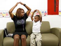 <p>Principal Onjaleke Brown coaches&nbsp;N.W. Harllee Early Childhood Center student&nbsp;A'lijah Pleasant through breathing exercises to calm him. Onjaleke uses a sofa in a hallway as her mobile office so she can be more visible to the students.&nbsp;</p>(David Woo/Staff Photographer)