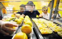 Students at Central Elementary school in Lewisville pick a fruit from the cafeteria line  September 15, 2010.  (David Woo/The Dallas Morning News)