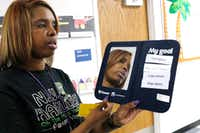 Onjaleke Brown, principal at N.W. Harllee Early Childhood Center in Dallas, holds a self-control board, something she uses with students to help correct their behavior.(David Woo/Staff Photographer)