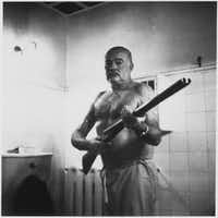 "Ernest Hemingway on guard at Finca Vigia, his home outside Havana. The Cuban Revolution led him to fear looters and kidnapping. From <i>Writer, Sailor, Soldier, Spy</i>,  by Nicholas Reynolds.(William Morrow/<p><span style=""font-size: 1em; background-color: transparent;"">Ernest Hemingway Photo Collection, JFK Library</span></p>)"