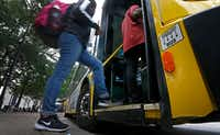 People board a DART bus at West Transfer Center in Dallas. (Jae S. Lee/Staff Photographer)
