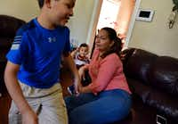 Marta Hernandez relaxes as her son Kenneth plays at his grandparents' home in Irving. (Ben Torres/Special Contributor)