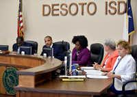 Carl Sherman Jr., DeSoto ISD president, second from left, conducts a school board meeting to discuss  the contract of DeSoto football head coach Todd Peterman at DeSoto ISD headquarters, Monday, May 8, 2017 in DeSoto. (Ben Torres/Special Contributor)
