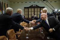 Texas Rep. Kevin Brady (front right) and President Donald Trump are both pursuing tax overhauls that would eliminate the state and local tax deduction.(Brendan Smialowski/AFP/Getty Images)