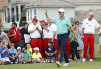 Jordan Spieth waves to the crowd as he is introduced  during a youth golf clinic at TPC Four Seasons in Irving before last year's Byron Nelson tournament. Behind him are members of the Dallas Salesmanship Club, wearing their trademark red pants.(2016 File Photo/Vernon Bryant)