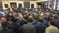 """<p><span style=""""font-size: 1em; background-color: transparent;"""">House members huddled at the back of the chamber late Thursday after Rep. Jonathan Stickland, center, and fellow Freedom Caucus members protested what they described as petty punishments by Speaker Joe Straus and his allies.</span></p>(Madlin Mekelburg/Staff)"""