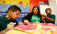 Teacher Felix Avila-Fleming (center) works with her pre-K students Rafael Suazo (left) and Cedric Grant in a classroom at N.W. Harllee Early Childhood Center in Dallas.(Jae S. Lee/Staff Photographer)