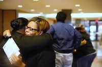 Sheritha Smith, Toya Smith's sister, hugs a relative of Zina Williams Bowser after Erbie Lee Bowser was sentenced to life in prison Friday. The jury could not agree on the death penalty.(Ron Baselice/Staff Photographer)