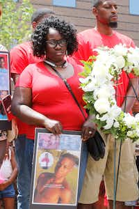 Charmaine Edwards and her husband, Odell Edwards, stand by a wreath placed on the steps of the Frank Crowley Courts Building during a rally Saturday remembering Jordan and others killed by police. (Ron Baselice/Staff Photographer)