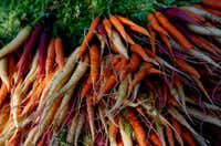 Carrots for sale at the stand of Megan Neubauer of Pure Land Organic at the McKinney Farmer's Market in historic Chestnut Square in McKinney.(ANJA SCHLEIN/Special Contributor)