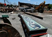 Demolition crews are razing the old El Corazon Mexican restaurant in the Bishop Arts area of Dallas on Monday.(Tom Fox/Staff Photographer)