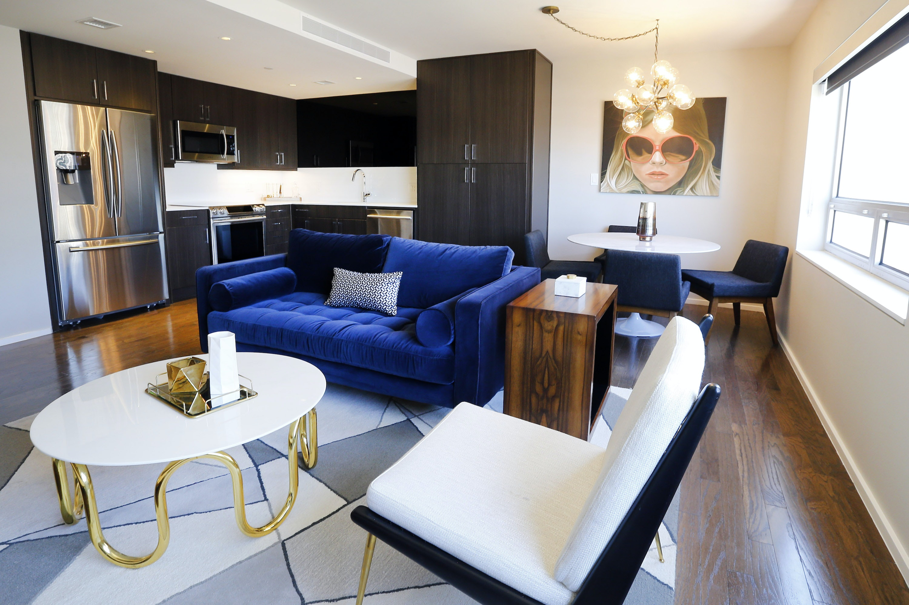 The Open Floor Plan Of Kitchen, Dining And Leisure Is Pictured In A Model  Apartment In The Statler Residences In Downtown Dallas.