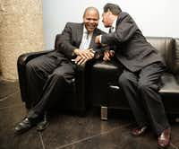 In this 2010 photo, Rep. Eric Johnson, D-Dallas, was still just an office hopeful when shares a moment with Rep. Roberto Alonzo (right) after a press conference where Johnson got endorsements from several Democratic officials at South Side on Lamar in Dallas.(Evans Cagalge/Staff Photo)
