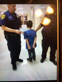 A student at Gabe P. Allen Charter School is handcuffed.(KXAS-TV (NBC5))