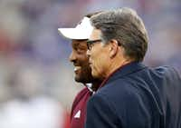 Energy Secretary Rick Perry, with Texas A&M football coach Kevin Sumlin, is a huge fan of the school, his alma mater. (Rogelio V. Solis/The Associated Press)