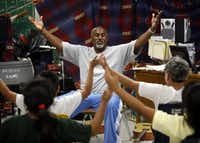 Osley Cook Jr., shown directing students during a 2011 summer camp, has dramatically transformed the Pinkston High School band. (File photo)