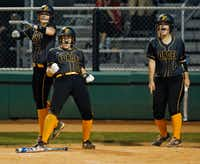 <p>Emily Galiano (right) celebrated with teammatesSavannah DesRochers (left) and Caroline Tedder during a game last month at Lovejoy High School.</p>(Stewart F. House/Special Contributor)