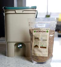 A bokashi compost bucket and bran kit from Bokashi Brothers at the Texas AgriLife Research Center.(Rose Baca/Staff Photographer)