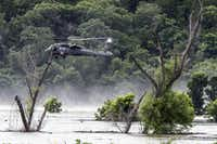 An Army helicopter hovered above Lake Belton on June 3, 2016, during the search for missing soldiers from Fort Hood. They were swept away as their truck went through a low-water crossing during training.(Rodolfo Gonzalez/Austin American-Statesman)