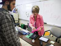 Dillan Akin works with campus technology specialist Vickie Dugan at Garland High School. As part of the $25 million program approved by voters in the district's 2014 bond election, each campus has an assigned specialist to work with students and staff.(Ashley Landis/The Dallas Morning News)
