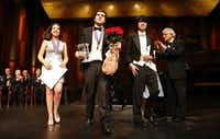 Van Cliburn International Piano Competition winners Beatrice Rana, 20, of Italy (Silver Medal), Vadym Kholodenko, 26, of Ukraine (Gold Medal) and Sean Chen, 24, of United States (Bronze Medal) walk to the front of the stage after their awards presentation at the Bass Performance Hall in Fort Worth in 2013.  (File Photo/Tom Fox)