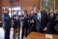 <p>Gentry Beach (left) receives a ceremonial pen from Interior Secretary Ryan Zinke as Zinke signed orders on March 2, his first day on the job.</p>(U.S. Department of Interior)