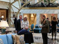<p>Gentry Beach (left) and his wife, Kathryn, visited the lobby of the Trump International Hotel in Washington, D.C., a few days before the inauguration.</p>(Eric Lipton/The New York Times)