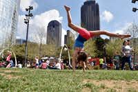 Sage Engelhardt, 8, of Coppell, practices her back-flips during a family visit to Klyde Warren Park in Dallas, during the Food Truck Frenzy, Saturday, March 18, 2017. The free event hosted a myriad of food trucks, more than usually available, along with live music and plenty of green space for family fun.(Ben Torres/Special Contributor)