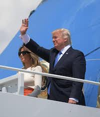 US President Donald Trump and First Lady Melania Trump make their way to board Air Force One before departing from Andrews Air Force Base in Maryland on May 19, 2017. (MANDEL NGAN/AFP/Getty Images)