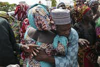 A father is reunited with one of the released Chibok girls in Abuja, more than three years after being kidnapped with more than 200 classmates. (Sunday Aghaeze/AFP/Getty Images