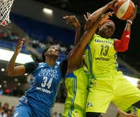 Dallas Wings guard Karima Christmas (13) and Dallas Wings center Courtney Paris (3) jump for possession of the ball against Minnesota Lynx center Sylvia Fowles (34) in the third quarter at College Park Center in Arlington, Texas on Saturday, May 20, 2017.(Rose Baca/Staff Photographer)