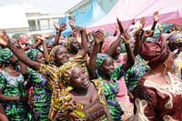 Shows some of the released Chibok girls celebrating before being reunited with their families on May 20, 2017, in Abuja. (AFP/Getty Images)