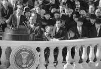 President John F. Kennedy delivers his inaugural address at the Capitol in Washington after taking the oath of office. Listening in the front row (from left): incoming Vice President Lyndon Johnson, outgoing Vice president and Kennedy's defeated presidential opponent Richard M Nixon, Sen John Sparkman, D- Ala., and former President Harry Truman. (The Associated Press)