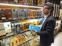 Marketing director Carlos Salcido inspects the expansive collection of tequilas for sale at El Palacio de Hierro's Polanco store.(Jay Jones/Special Contributor )