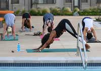 Veleisa Burrell teaches yoga class poolside at Alexan West Dallas apartments.<div><br></div>(Robert W. Hart/Special Contributor)