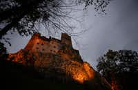 In this picture taken Oct. 9, 2016, Bran Castle lies on top of cliffs in Bran, Romania. Airbnb has launched a contest to find two people to stay overnight in the castle on Halloween, popularly known as Dracula's castle because of its connection to the cruel real-life prince Vlad the Impaler, who inspired the legend of Dracula.  (AP Photo/Andreea Alexandru)(Andreea Alexandru/AP)