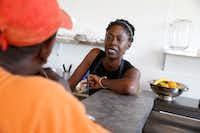 Tisha Crear talks to Otis Buford at her vegan restaurant in Dallas.(Nathan Hunsinger/Staff Photographer)