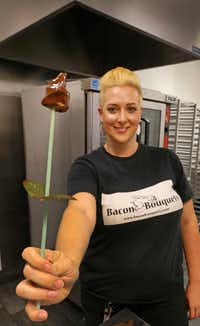 Meredith Browning holds a chocolate-dipped bacon rose, which she makes for her business, Bacon Bouquets. (Louis DeLuca/Staff Photographer)