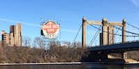 This billboard on Minneapolis' Third Avenue Bridge recalls when Grain Belt beer was brewed in the city. It's now produced by August Schell in New Ulm, Minn.(Sheryl Jean)